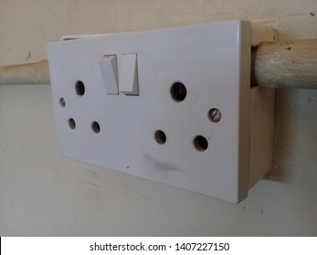 Two three-pin round electrical power sockets for a residential household. Socket where to get electrical power.