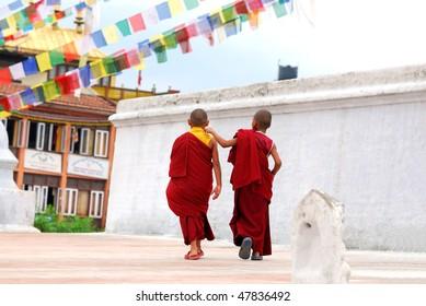 Two Tibetan Children Buddhist Monks walking