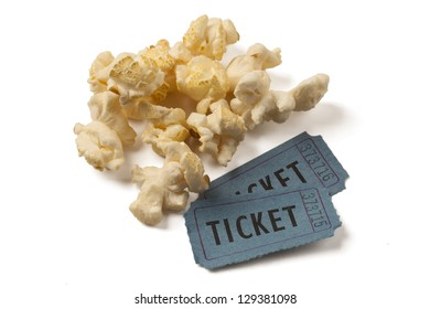 Two ticket stubs with popcorn on white background. Clipping path included.