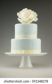 two tier fondant cake with peony on top