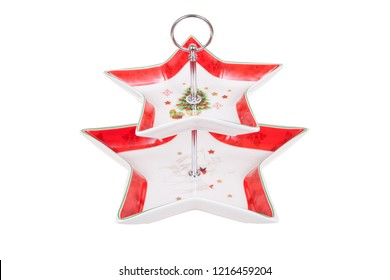 Two tier serving tray with christmas decoration, star shaped, isolated on white