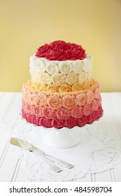 Two tier wedding cake with buttercream rose swirls