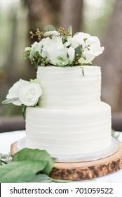 Two Tier White Wedding Cake with Florals