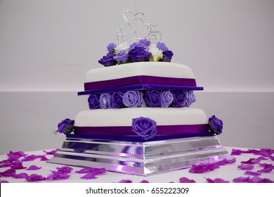 Two tiered purple themed wedding cake