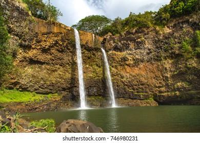 Two tiered, waterfalls cascade over a cliff, into pool below, Wailua Falls Kauai, Hawaii
