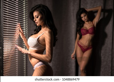 Two times the same girl in room with blinds
