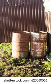 two tin barrels for garbage