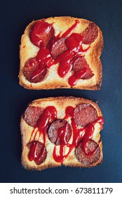 Two toasts. Three toasts with sausage and ketchup. Home made sandwiches baked in oven