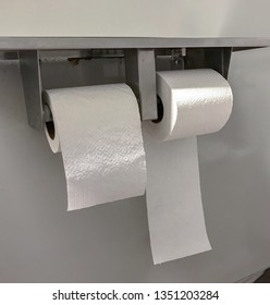 Two toilet paper rolls facing opposite ways