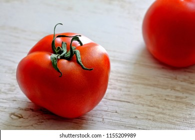 Two tomatoes on the table