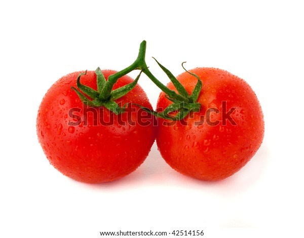Two tomatoes with water drops over white background