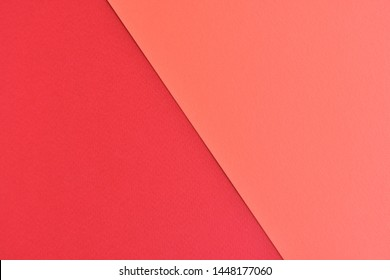 Two tone paper background with red and orange color. Blank colorful backdrop with empty space for image or text. Mockup concept. Neon empty paper background. Clean orange and red wallpaper