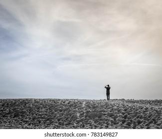 Two tone skyline over beach sand