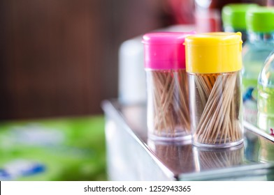 Two toothpick colorful bottles.