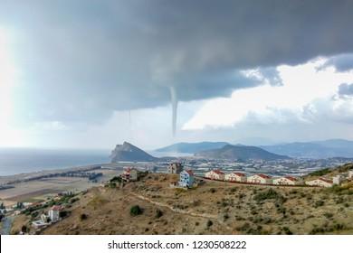 Two tornados, bigger and smaller, above the Mediterranean sea in Turkey, Gazipasha, Antalya province, November, 11, 2018.