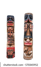 Two totem poles with tribal faces and various carvings isolated on white background