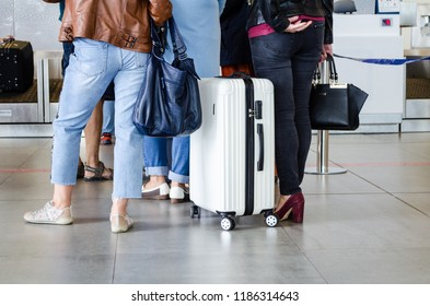 two tourist girls with a big white suitcase on wheels at the airport, Luggage for travel