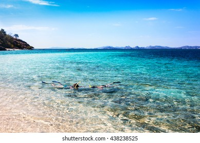 Two tourist snorkeling in Flores Island, Indonesia