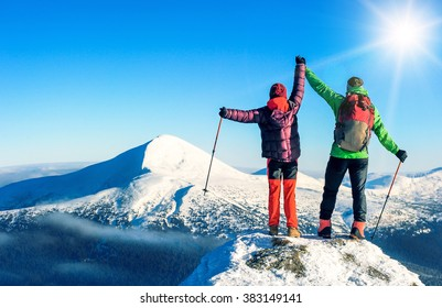 Two tourists reaching the summit. Active sport concept