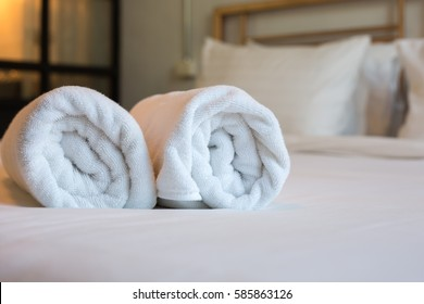 Two towels on the bed in hotel room