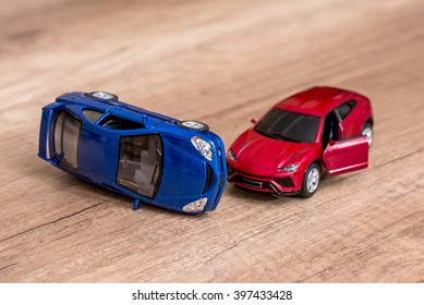 two toy cars on desk