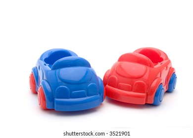 two toy cars, one red, one blue, isolated on white