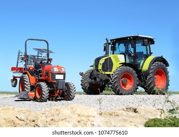 Two Tractor on a bright sunny day.