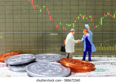 Two traders are making agreement in stock investment. (business commitment for investment concept)