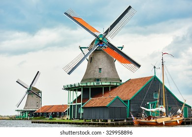 two traditional dutch windmill near the canal in Zaanse Schans Netherlands