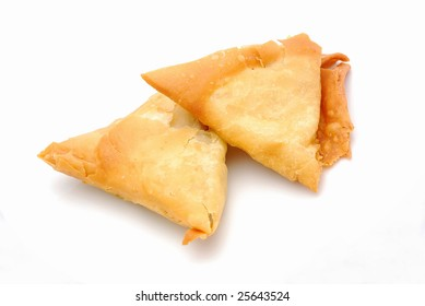 Two traditional South African Samoosa triangles filled with chicken and beef mince isolated on white background