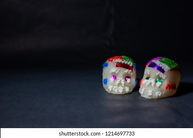 Two traditional sugar skulls