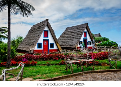 Two traditional thatched triangular houses in Santana, Madeira 04-Sep-2016