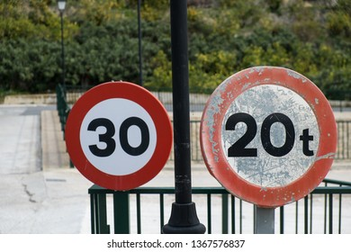 Two traffic signs with speed and weight limits