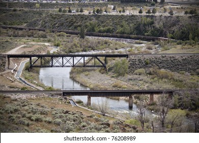 Two train bridges over a river.