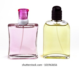 two transparent bottles with pink and yellow liquid cologne