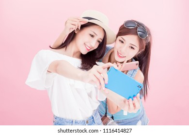two travel woman selfie happily with travel concept on the pink background