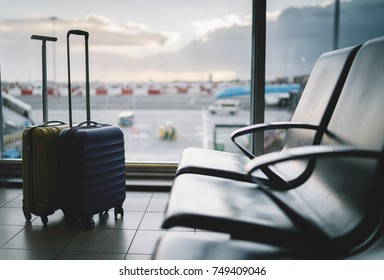 Two traveler suitcases in the airport terminal waiting area, winter vacation concept, traveling and enjoying concept