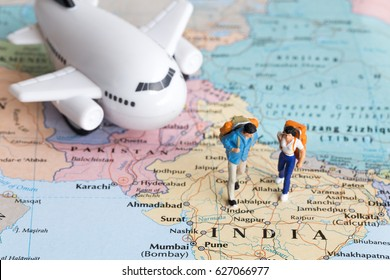 Two traveller model walking on map together, people travel in india, travel concept.
