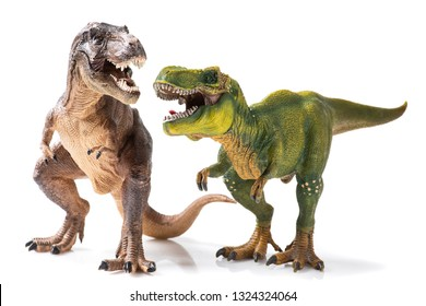 Two T-rex plastic figurines on white background