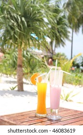 Two tropical cocktails near beach