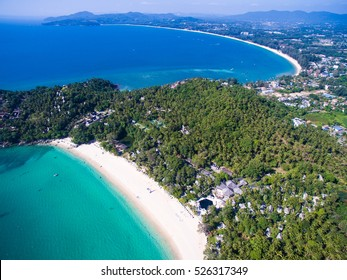 Two tropical white sandy beaches with turquoise clear water and palm trees. Top view. Aerial shooting of Pansee and Bangtao beaches at Phuket, Thailand