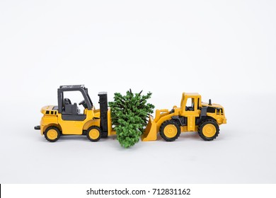 Two truck moving Christmas tree isolate on white background