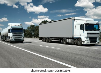 two trucks with container and cistern on road, cargo transportation concept