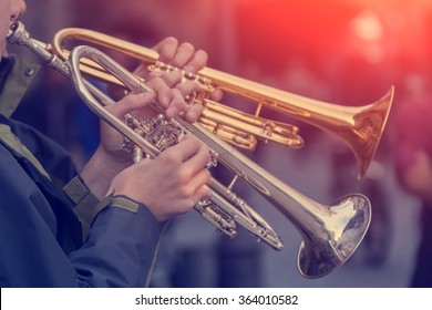 Two tubes in the hands of musicians