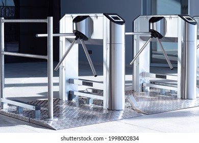 Two turnstiles inside the building. Access control equipment. Two turnstiles at aisle in business center. Concept - sale of access control equipment. Magnetic card access turnstiles.