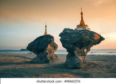 Two twin pagodas (Kyauk Maumghnama Pagoda) at Ngwe Saung beach, Bay of Bengal, Myanmar (Burma).