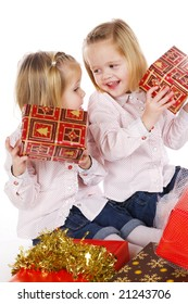 two twin sisters with christmas gifts