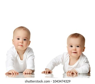 Two twin sisters infant child baby girls toddler sitting in white shirt happy smiling isolated on a white background