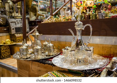 Two types of beautiful Omani Coffee (kahwa) cups and jug sets on display in a retail shop in Muscat, Oman.