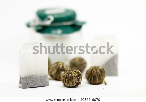 Two types of tea and blurred glass bottle on the background